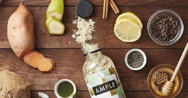 A picture of an open bottle of AMPLE surrounded by the foods that go into it.
