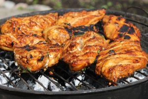 Delicious BBQ chicken on a grill. Thanks to super BBQ hacks.