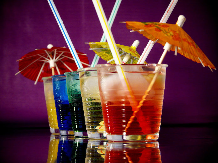 An image of brightly colored cocktails, like the ones you can make from these recipes.