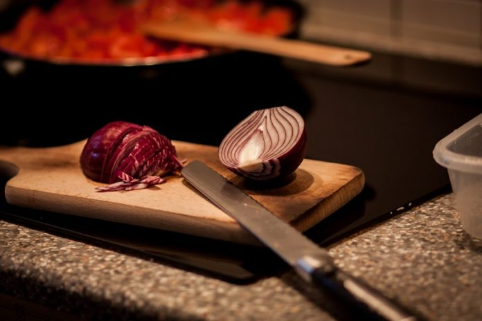 Here you see an onion lined up to make some tasty dishes. Watch the video to see some cool food tricks.