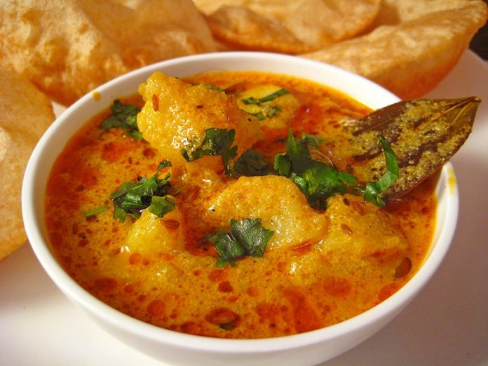 A steaming bowl of fresh curry, just like the ones in this video.