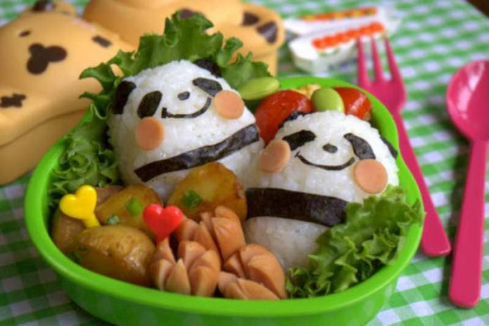 Two cute pandas made entriely out of rice. Food art rocks.