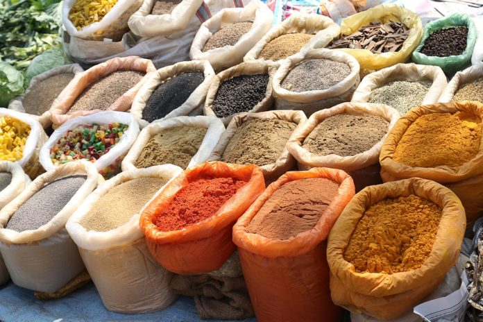 A huge array of tasty looking spices in sacks. This is a great way to reduce your food costs.