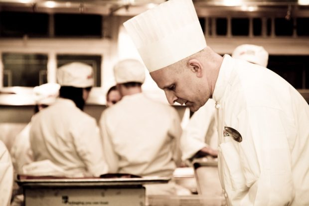 An image of a chef inspecting the handy work of a kitchen hack.