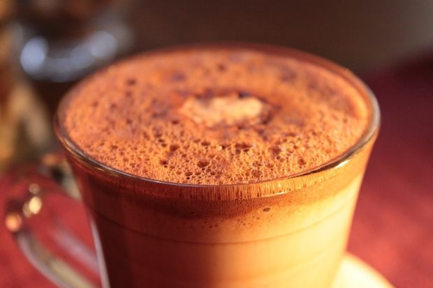 A coffee dusted with chocolate that looks oh so inviting.