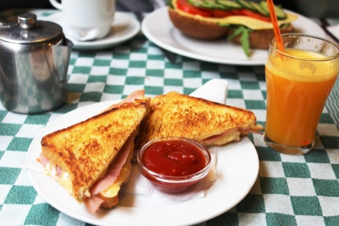 Here you can see some lovely toasted cheese and ham sandwiches served with some ketchup, which is the best way to eat them.