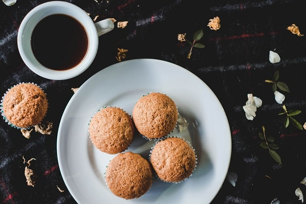 four muffins with coffee