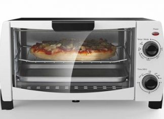 a silver toaster oven with pizza in it