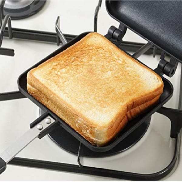 a sandwich being made on the stovetop panini press
