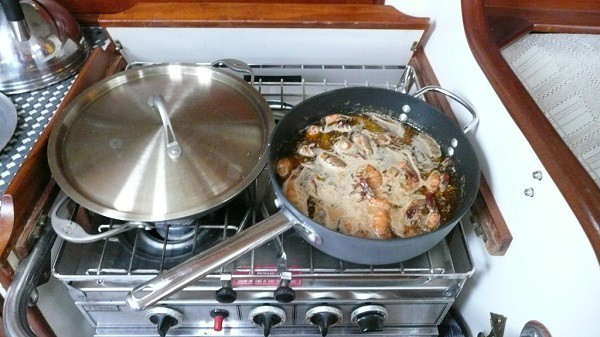 jambalaya being made in a dutch oven
