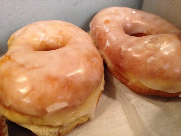 two glazed raised donuts