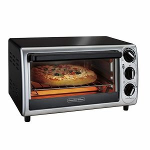 a silver and black proctor silex toaster oven with a pizza in it