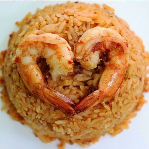 two shrimps on top of fried rice