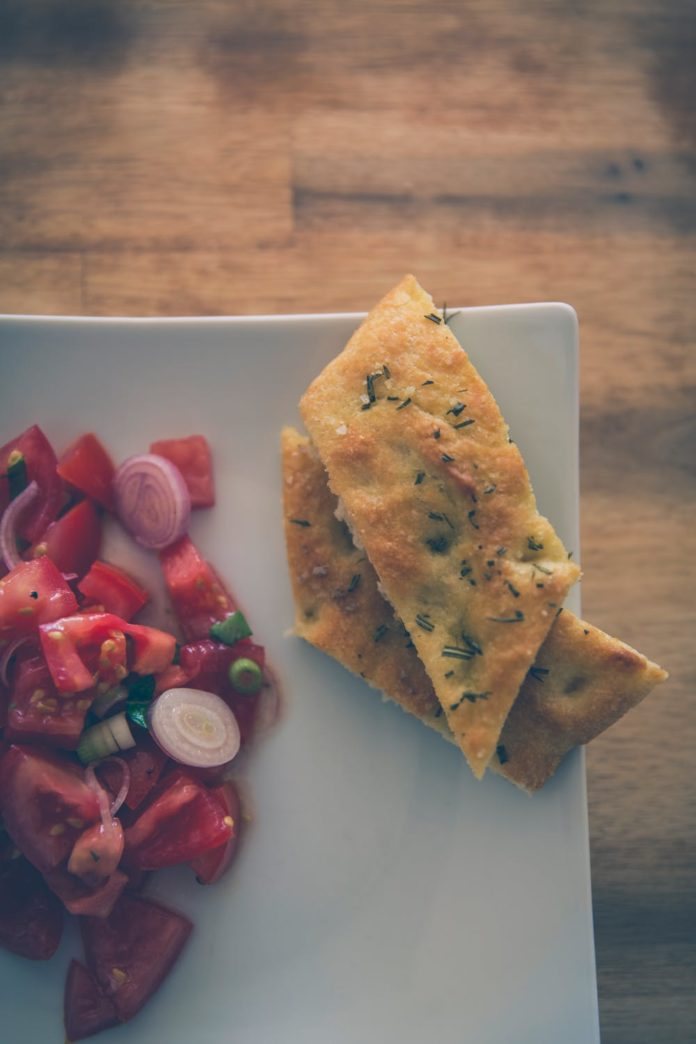 plate of focaccia and tomato salad
