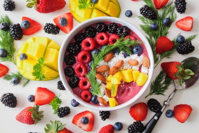 bowl of yoghurt strawberries and blackberries