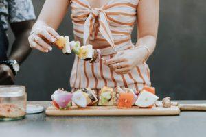 woman making skewers