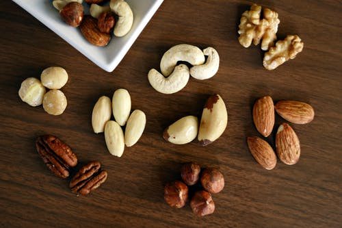 cashews and different types of nuts on table