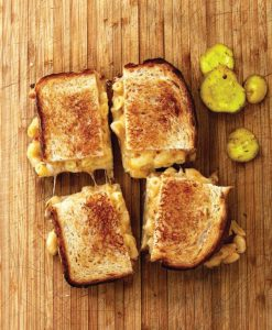 a grilled mac and cheese sandwich split in 4 parts