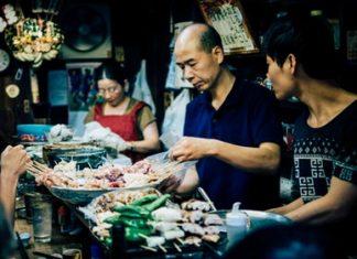 man making shinjuku skewers