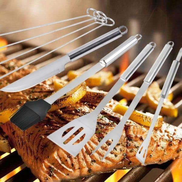 grilling equipment with grilled salmon in the background