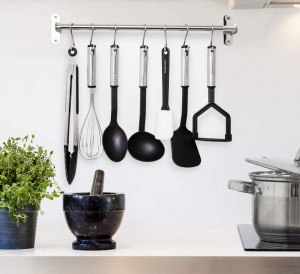 home hero utensils mounted on kitchen wall