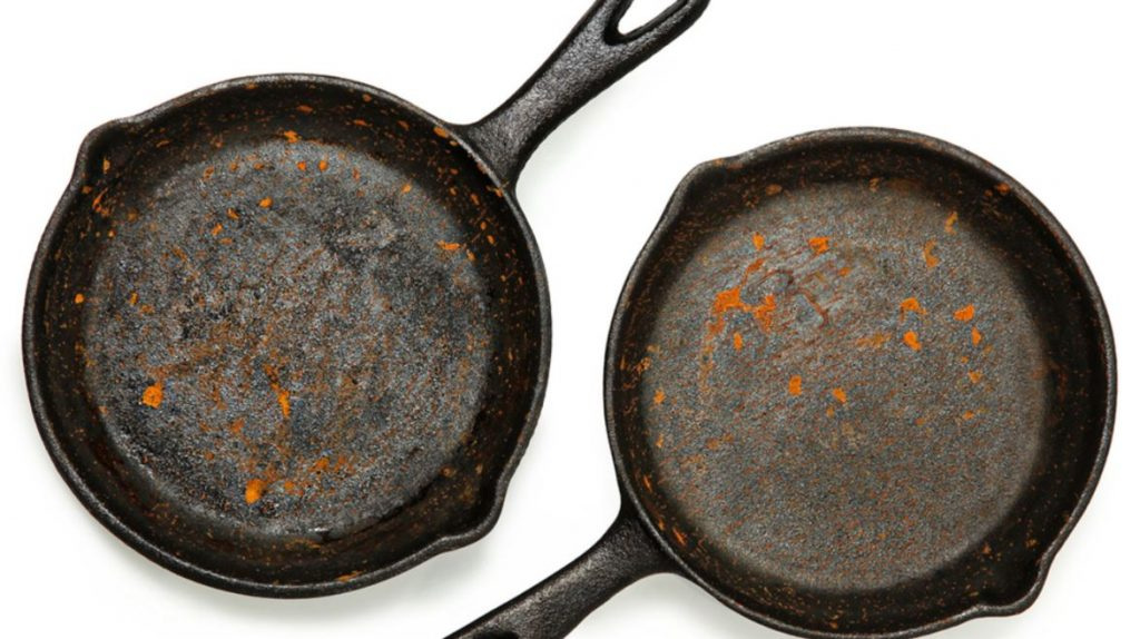 dirty and rusty cast iron pans